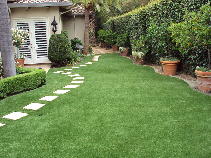 by planted areas in this backyard has a charming and soothing effect