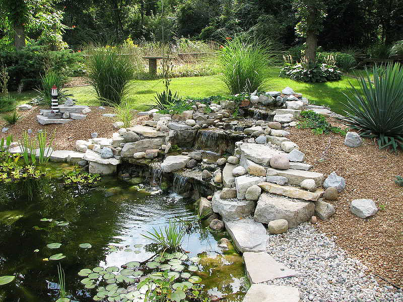 Inspiring backyard pond ideas quiet corner for Garden pond waterfall ideas