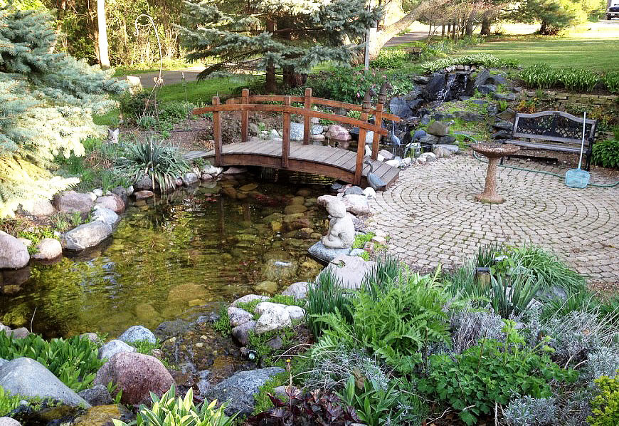 Pin backyard ponds on pinterest for Garden pool designs ideas