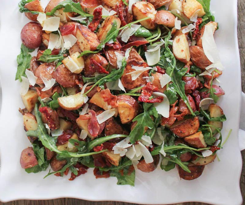 Roasted Potato Salad with Pancetta Sun Dried Tomatoes and Arugula