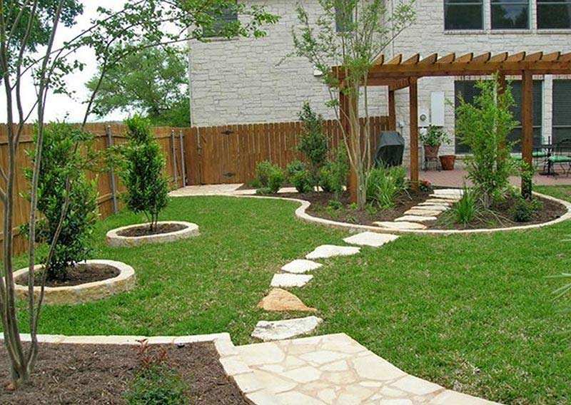 Small yard landscaping design quiet corner for Simple garden designs for small gardens
