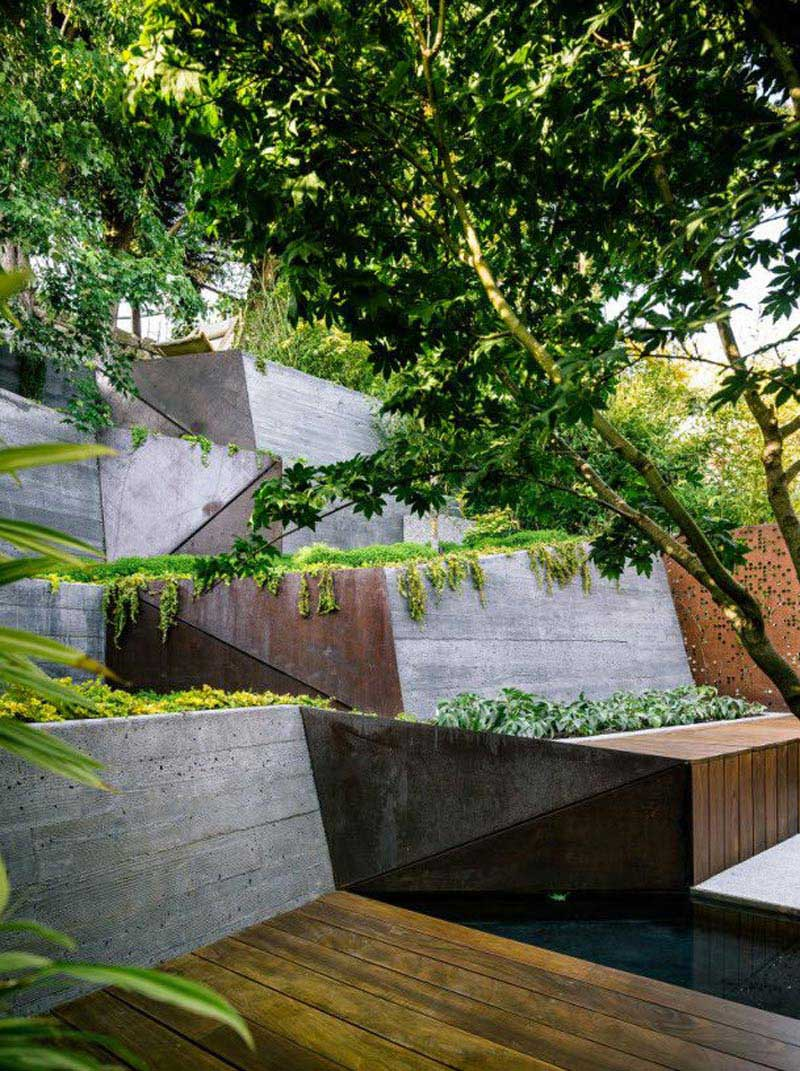 Sloping garden design ideas quiet corner for Pool design sloped yard