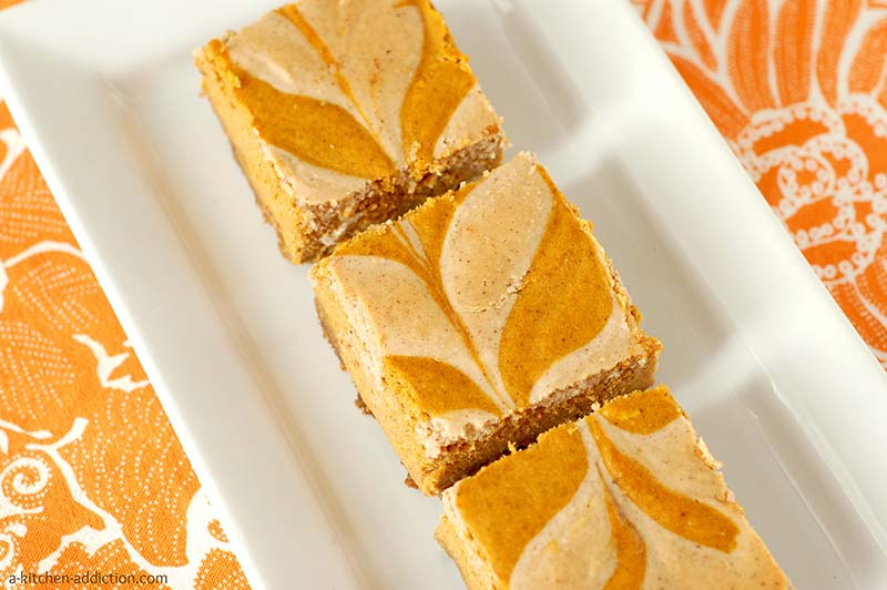 Pumpkin Pie Cheesecake Bars with White Chocolate Vanilla Swirl