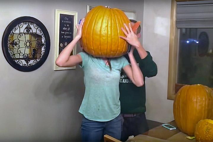 Teen gets her head stuck inside a giant pumpkin!